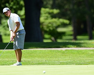 WARREN, OHIO - JULY 16, 2015: Brian Terlesky of Boardman follows through on his putt on the 12th hole Thursday afternoon during a Vindy Greatest Golfer qualifying Tournament. DAVID DERMER | THE VINDICATOR