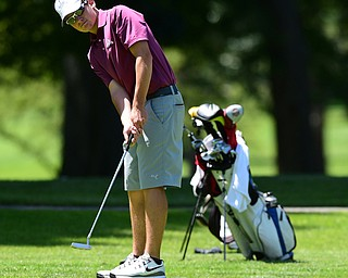 WARREN, OHIO - JULY 16, 2015: Brian Velasquez of Poland follows through on his putt on the 12th hole Thursday afternoon during a Vindy Greatest Golfer qualifying Tournament. DAVID DERMER   THE VINDICATOR