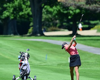 WARREN, OHIO - JULY 16, 2015: Kristin Shelley of Canfield follows through on her approach shot on the 1st hole Thursday afternoon during a Vindy Greatest Golfer qualifying Tournament. DAVID DERMER | THE VINDICATOR