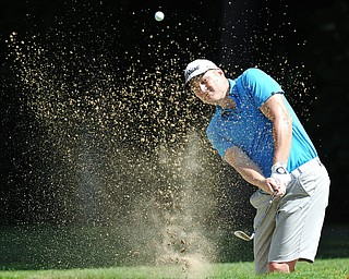 Jeff Lange | The Vindicator  AUGUST 22, 2015 - Keith Schubert of Girard looks through a wall of sand as he blasts his way out of the No. 5 bunker during Saturday's Greatest Golfer of the Valley tournament held at Youngstown Country Club.