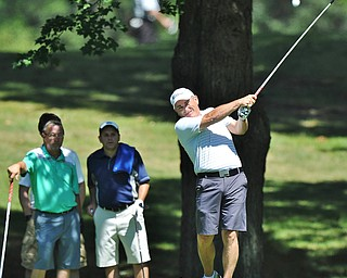 Jeff Lange | The Vindicator  AUGUST 22, 2015 - Ed Nappi of Columbiana watches his shot from the tee as Wendell Wagnon and Matt DiLoreto look on from behind during Saturday's Greatest Golfer of the Valley tournament held at Youngstown Country Club.