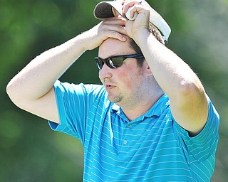 Jeff Lange | The Vindicator  AUGUST 22, 2015 - Steven Smoot of Brookfield wipes the sweat from his forehead during Saturday's Greatest Golfer of the Valley tournament held at Youngstown Country Club.