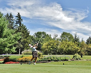 Jeff Lange | The Vindicator  AUGUST 22, 2015 - Paul Keller of Canfield smacks his ball off the No. 8 tee during Saturday's Greatest Golfer of the Valley tournament held at Youngstown Country Club.