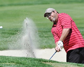 Jeff Lange | The Vindicator  AUGUST 23, 2015 - Daniel Horace of Austintown attempts to hit his ball out of the No. 7 bunker during Sunday's Greatest Golfer of the Valley tournament held at the Lake Club.