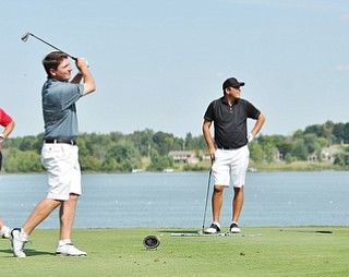 Jeff Lange | The Vindicator  AUGUST 23, 2015 - Jonah Karzmer of Poland (center), Michael Porter (left) and Scott Porter look on at Karzmer's tee shot late in the Greatest Golfer tournament held at the Lake Club in Poland, Sunday afternoon.