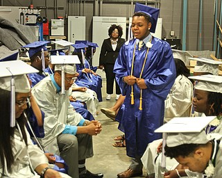 William d Lewis the vindicator  YEC graduate Jordan Rawl leads fellow grads in prayer before comencement ceremony 5-6-16 .