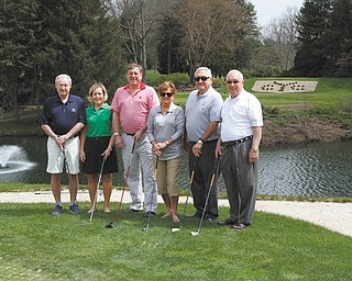 ROBERT K. YOSAY|THE VINDICATOR Among those preparing for the sixth annual Clubs for Kids Golf Classic are, from left, Paul Dutton, Sallie Dutton, David Tod II, Judy Schmutz, Reid Schmutz and Jim Siser.