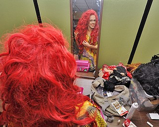 Jeff Lange | The Vindicator  FRI, MAY 6, 2016 - Lola Vanhorn of Poland does her hair prior to the start of Friday night's Pride Pageant held at YSU.
