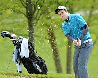 Jeff Lange   The Vindicator  SUN, MAY 15, 2016 - Howland's Joey Vitali watches his shot from the bunker on hole three during Sunday's Greatest Golfer of the Valley junior event at Avalon Lakes at Squaw Creek.