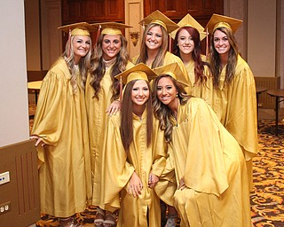 Nikos Frazier | The Vindicator..A group of students from Cardinal Mooney High School pose for a picture in Stambaugh Auditorium before walking upstairs to receive their diplomas.