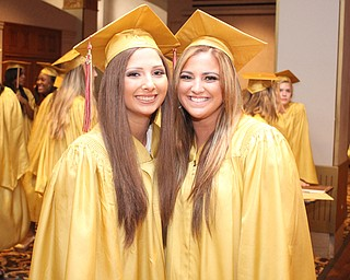 Nikos Frazier | The Vindicator..Lexy Herman(left) poses next to Julie Cook(right) before walking upstairs to receive their diplomas from Cardinal Mooney High School.