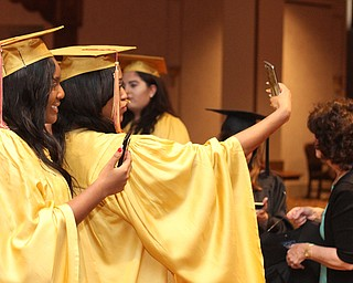 Nikos Frazier | The Vindicator..Destiny love(left) and Brandi Lambert(right) take a selfie in Stambaugh Auditorium before receiving their diplomas from Cardinal Mooney High School.
