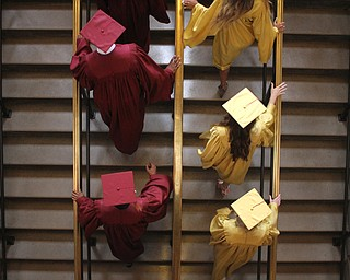 Nikos Frazier | The Vindicator..Cardinal Mooney students walk up the stairs of Stambaugh Auditorium at the 2016 commencement.