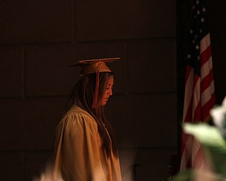 Nikos Frazier | The Vindicator..Julie Cook waits to walk on stage at Stambaugh Auditorium to receive her diploma from Cardinal Mooney High School.