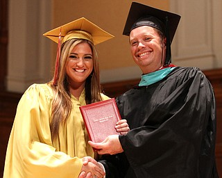 Nikos Frazier | The Vindicator..Julie Cook receives her Cardinal Mooney High School diploma from Principal Mark Vollmer.
