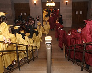 Nikos Frazier | The Vindicator..After receiving their diplomas from Cardinal Mooney High School, the class of 2016 walk downstairs to greet their families.