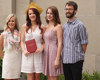Nikos Frazier | The Vindicator..(left to right) Jayne Dimascio, Anne Alcorn, Emily Alcorn and Joe Alcorn pose for photos outside of Stambaugh Auditorium after Anne Alcorn graduated from Cardinal Mooney High School.