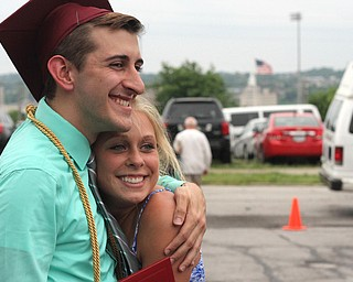 Nikos Frazier | The Vindicator..Gino Ginnetti(left) poses with Kirsten Appel after graduating from Cardinal Mooney High School.