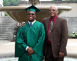 Nikos Frazier | The Vindicator..Ryan Stuart(left) poses with his grandfather, Mark Scott outside of Stambaugh Auditorium before the 2016 Ursline High School commencement on Sunday, May 29, 2016.
