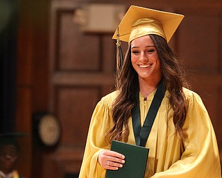 Nikos Frazier | The Vindicator..Makayla Berry walks off stage after receiving her diploma from Ursline High School.