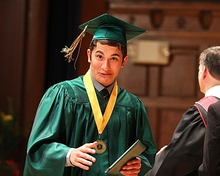 Nikos Frazier | The Vindicator..Anthony Morgione walks off stage after receiving his diploma from Ursline High School.