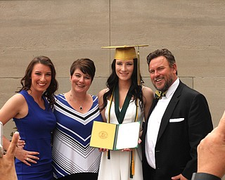 Nikos Frazier | The Vindicator..(left to right) Victoria Lehn, Erica Lehn, Alexandria Rossetti and William Lehn pose for pictures outside of Stambaugh Auditorium after Erica received her diploma from Ursline High School.