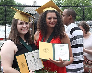 Nikos Frazier | The Vindicator..Maura Rubinic(left) and Angelica Kratzer(right) pose for pictures outside of Stambaugh Auditorium after graduating from Ursline High School.