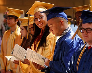 ROBERT  K. YOSAY | THE VINDICATOR..Graduates   check out their names.. as the ceremony....started..Valley Christian Schools --Highway Tabernacle Church..almost 40 graduates  celebrated graduation - ..-30-