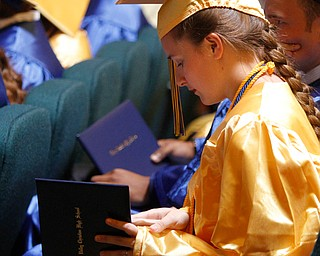 ROBERT  K. YOSAY | THE VINDICATOR..Sara Reichard   checks out her diploma..Valley Christian Schools --Highway Tabernacle Church..almost 40 graduates  celebrated graduation - ..-30-