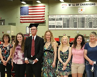 Honorary veteran graduate, Robert Wallace (center) poses for a picture with his family after he was given a diploma during the Struthers High School Commencement on Sunday afternoon.   Dustin Livesay   |   The Vindicator 5/29/16  Struthers High School    (the whole famile left and I could not get names. )