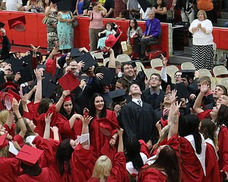 The graduating class of Struthers High School throw iup their caps after singing the alma mater to conclude the Struthers High School Commencement on Sunday afternoon.   Dustin Livesay   |   The Vindicator 5/29/16  Struthers High School