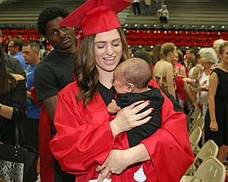 Struthers graduate Alexis Gleydura holds her six month old son, Keith Lawrence III,  after she received her diploma during the Struthers High School Commencement on Sunday afternoon.   Dustin Livesay   |   The Vindicator 5/29/16  Struthers High School