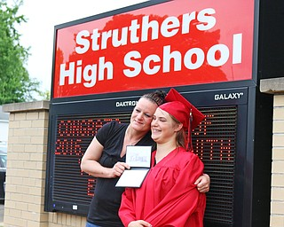Sabrina Welce (right) poses for a picture in front of the Struthers High School sign with her mother Kelly Bucker after the Struthers High School Commencement on Sunday afternoon.  Dustin Livesay  |  The Vindicator  5/29/16  Struthers High School.