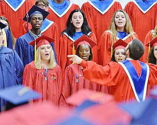 Jeff Lange | The Vindicator  SUN, MAY 29, 2016 - The Fitch Concert Choir featuring members of the class of 2016 performs the class song during Sunday's commencement at Austintown Fitch High School.