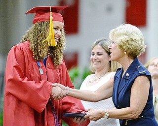 Jeff Lange | The Vindicator  SUN, MAY 29, 2016 - Bella Caruso (left) shakes hands with Kathy Mock as she receives her diploma during commencement at Austintown Fitch High School on Sunday.