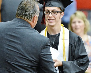 Jeff Lange | The Vindicator  SUN, MAY 29, 2016 - Isaac Beach smiles as he receives his high school diploma during Sunday's commencement at Girard High School.