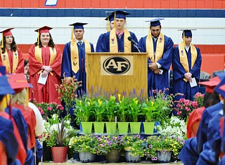 Jeff Lange | The Vindicator  SUN, MAY 29, 2016 - Austin Coulter (center) delivers a speech to his peers during Sunday's commencement at Austintown Fitch High School.