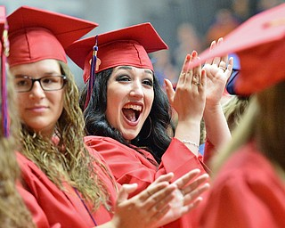 Jeff Lange | The Vindicator  SUN, MAY 29, 2016 - Alana DeFranco (center) claps in excitement as names are called during Sunday's commencement at Austintown Fitch High School.