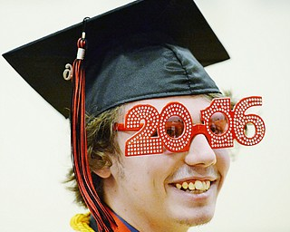 Jeff Lange | The Vindicator  SUN, MAY 29, 2016 - Matthew Bowman of Girard grins as wears a pair of 2016 glasses prior to the start of Sunday's commencement at Girard High School.