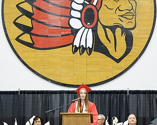 Jeff Lange | The Vindicator  SUN, MAY 29, 2016 - Girard Valedictorian Gabriella Cario delivers a speech to her classmates during Sunday's commencement at Girard High School.