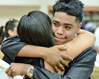 Jeff Lange | The Vindicator  SUN, MAY 29, 2016 - Angel Wilson (facing) hugs his mother Christina Marquez of Girard after receiving his high school diploma Sunday afternoon at Girard High School.