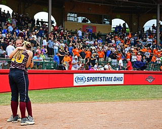 AKRON, OHIO - JUNE 4, 2016: Morgan Caopur #20 of South Range hugs teammate Felecia Gaeta #1 on the field after being defeated in Saturday afternoons Division 3 State Title game at Firestone Stadium. Wheelersburg won 8-3. DAVID DERMER | THE VINDICATOR