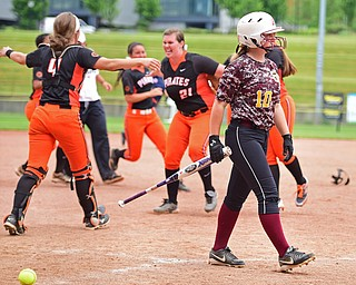 AKRON, OHIO - JUNE 4, 2016: Hope Thomas #10 of South Range walks to the dugout after striking out while the Wheelersburg players celebrate winning on the infield after the seventh inning of Saturday afternoons Division 3 State Title game at Firestone Stadium. Wheelersburg won 8-3. DAVID DERMER | THE VINDICATOR