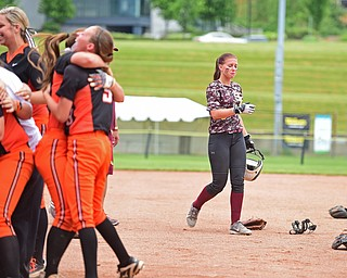 AKRON, OHIO - JUNE 4, 2016: Felecia Gaeta #1 walks to the dugout after being stranded on second base while the Wheelersburg players celebrate winning on the infield after the seventh inning of Saturday afternoons Division 3 State Title game at Firestone Stadium. Wheelersburg won 8-3. DAVID DERMER | THE VINDICATOR