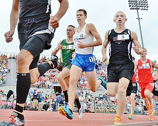 Jeff Lange | The Vindicator  SAT, JUN 4, 2016 - Maplewood's Allen Sparks (center) and Mathews' Kenny Wallace (right) compete in the boys 1,600 meter run during Saturday's OHSAA State Track and Field tournament held at Jesse Owens Memorial Stadium in Columbus. Sparks and Wallace finished fourth and fifth with times of 4:19.70 and 4:19.88, respectively.