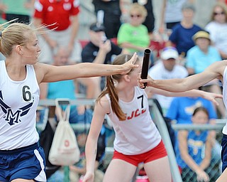 Jeff Lange | The Vindicator  SAT, JUN 4, 2016 - McDonald's Iva Domitrovich (right) hands the baton off to teammate Sara Joseph as they compete in the Division III girls 4x400 meter relay race during Saturday's OHSAA State Track and Field meet in Columbus. The team finished first with a time of 3:57.58.
