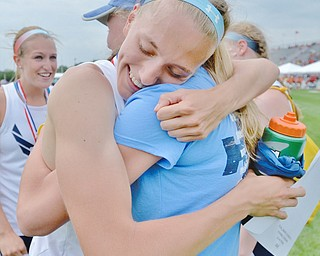 Jeff Lange | The Vindicator  SAT, JUN 4, 2016 - McDonald's Iva Domitrovich (facing) hugs Brenna Rupe after the McDonald 4x400 team placed first with a time of 3:57.58 during Saturday's OHSAA State Track and Field tournament in Columbus.
