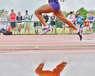 Jeff Lange | The Vindicator  SAT, JUN 4, 2016 - After a brief storm delay, Pickerington Central's Trinity Brown competes in the Division I girls 4x100 meter relay race during the OHSAA State Track and Field tournament held at Jesse Owens Memorial Stadium in Columbus on Saturday, June 4, 2016.