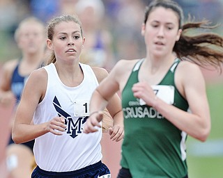 Jeff Lange | The Vindicator  SAT, JUN 4, 2016 - McDonald's Malina Mitchell (left) competes in the girls 1,600 meter run during Saturday's OHSAA State Track and Field tournament in Columbus.