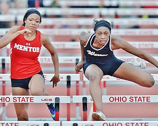 Jeff Lange | The Vindicator  SAT, JUN 4, 2016 - Harding's Gariana Bercheni (right) competes against Mentor's Aysha Muhammad in the girls 100 meter hurdles during Saturday's OHSAA State Track and Field tournament in Columbus.